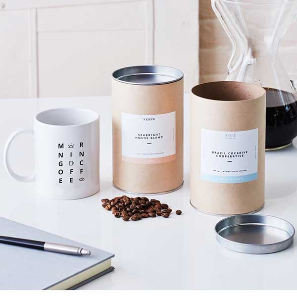 Mug and Canisters of Popular Coffee Roasts